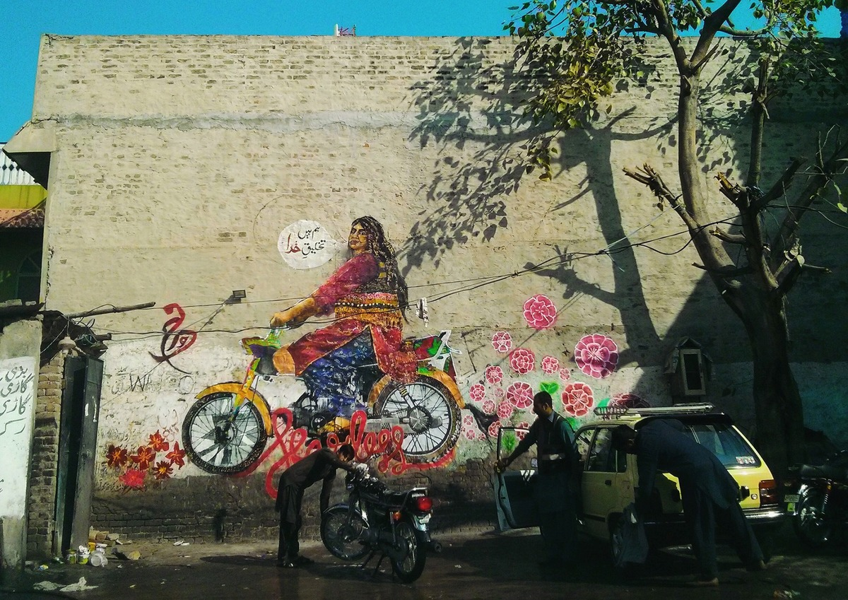 The mural in Rawalpindi depicts a trangender activist Babli riding a motorcycle.